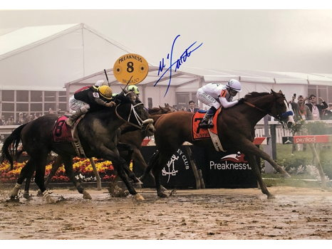 Framed Photo of Justify Winning the Preakness Stakes Autographed by Mike Smith
