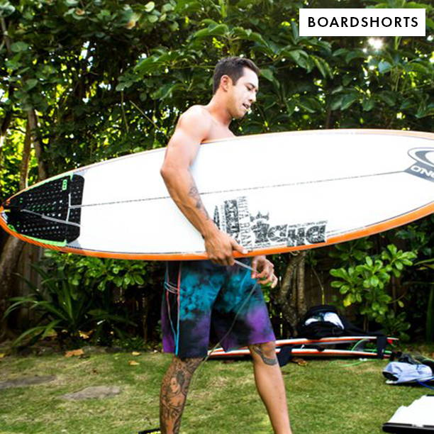 Shop Boardshorts. Man Surfing