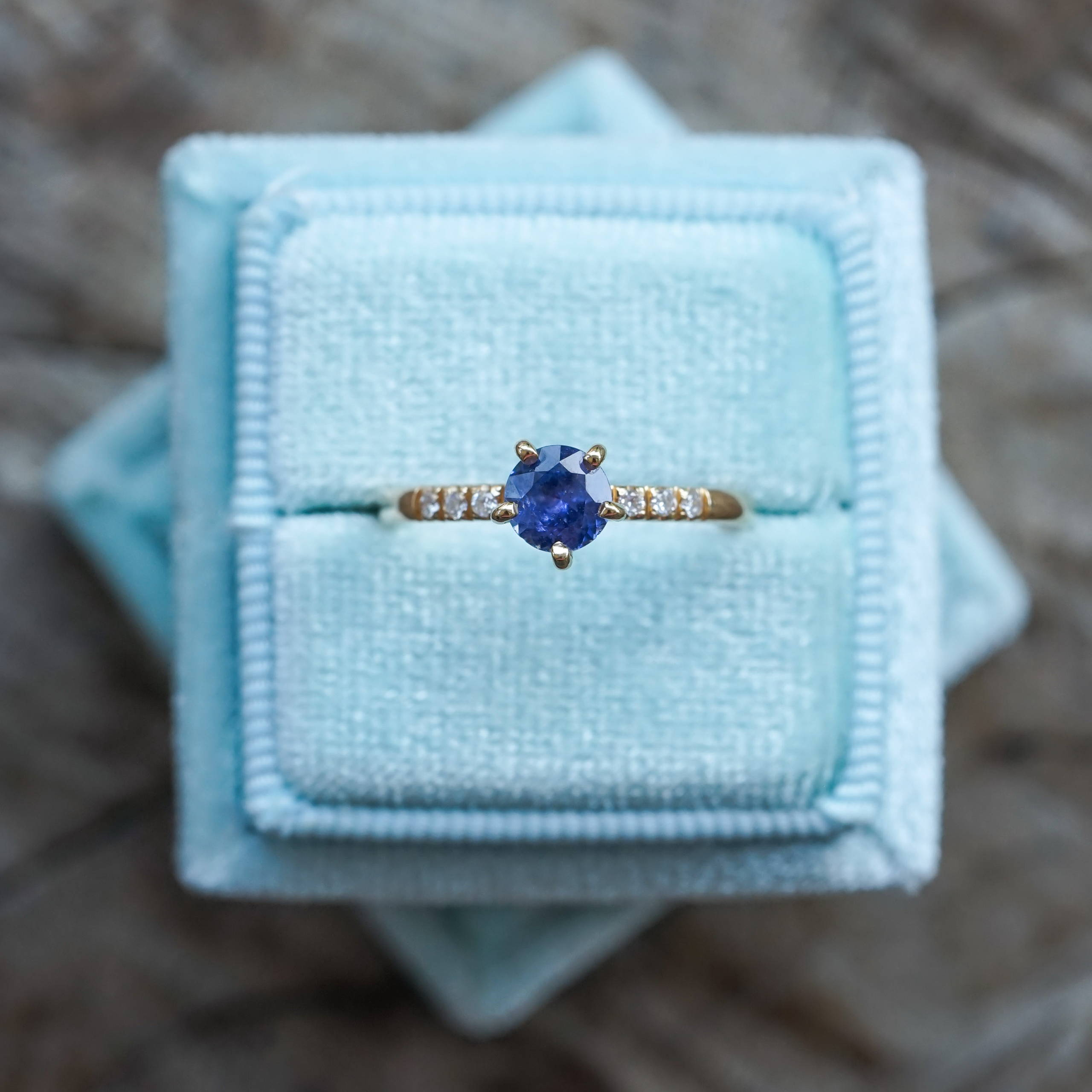 A stunning sapphire set in an ethical gold band accompanied by conflict free diamonds.