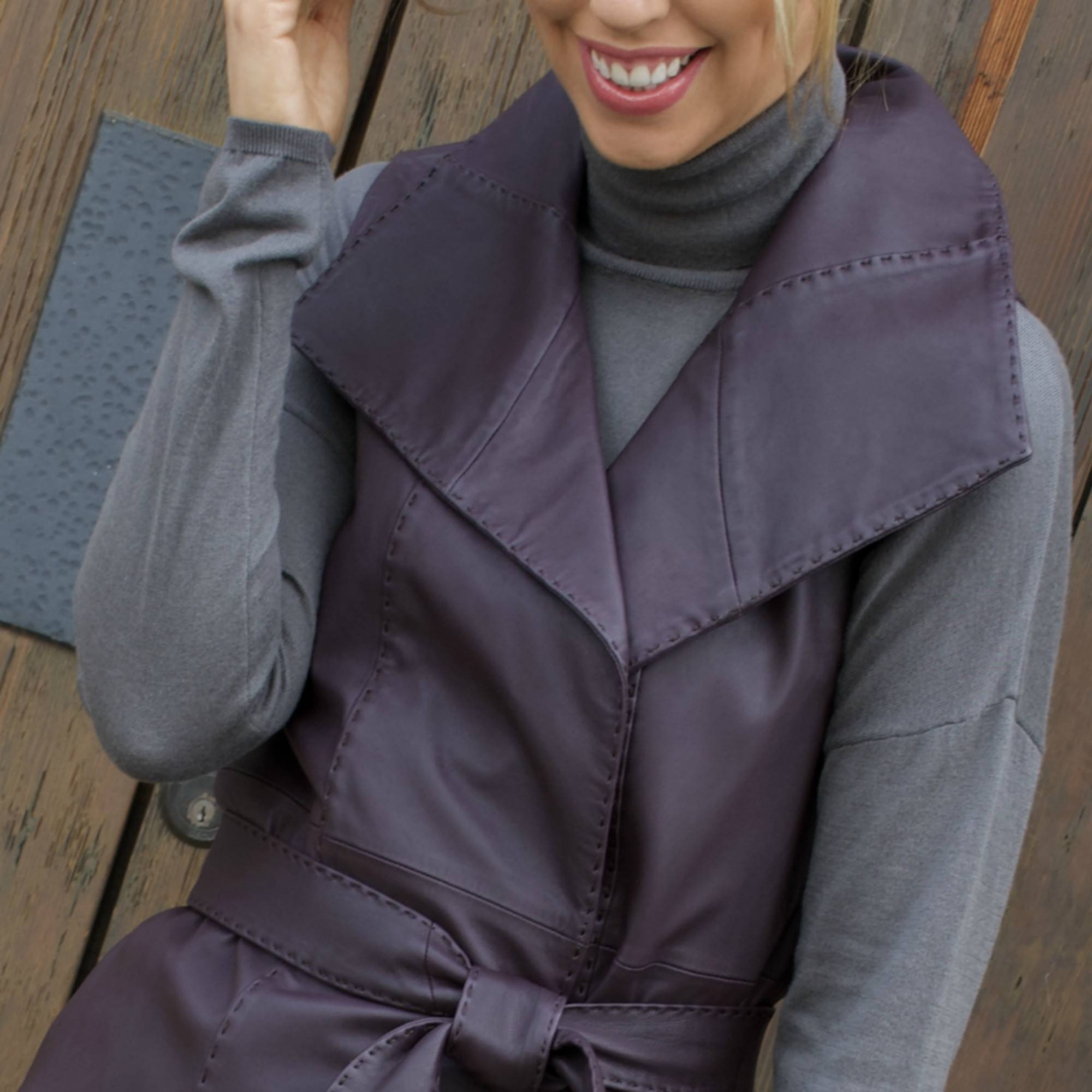 leather belted vest in plum