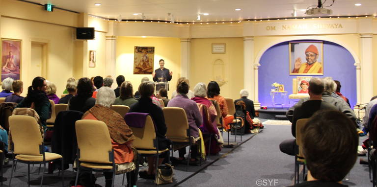 Melbourne Ashram Main Hall With Participants seated in chairs