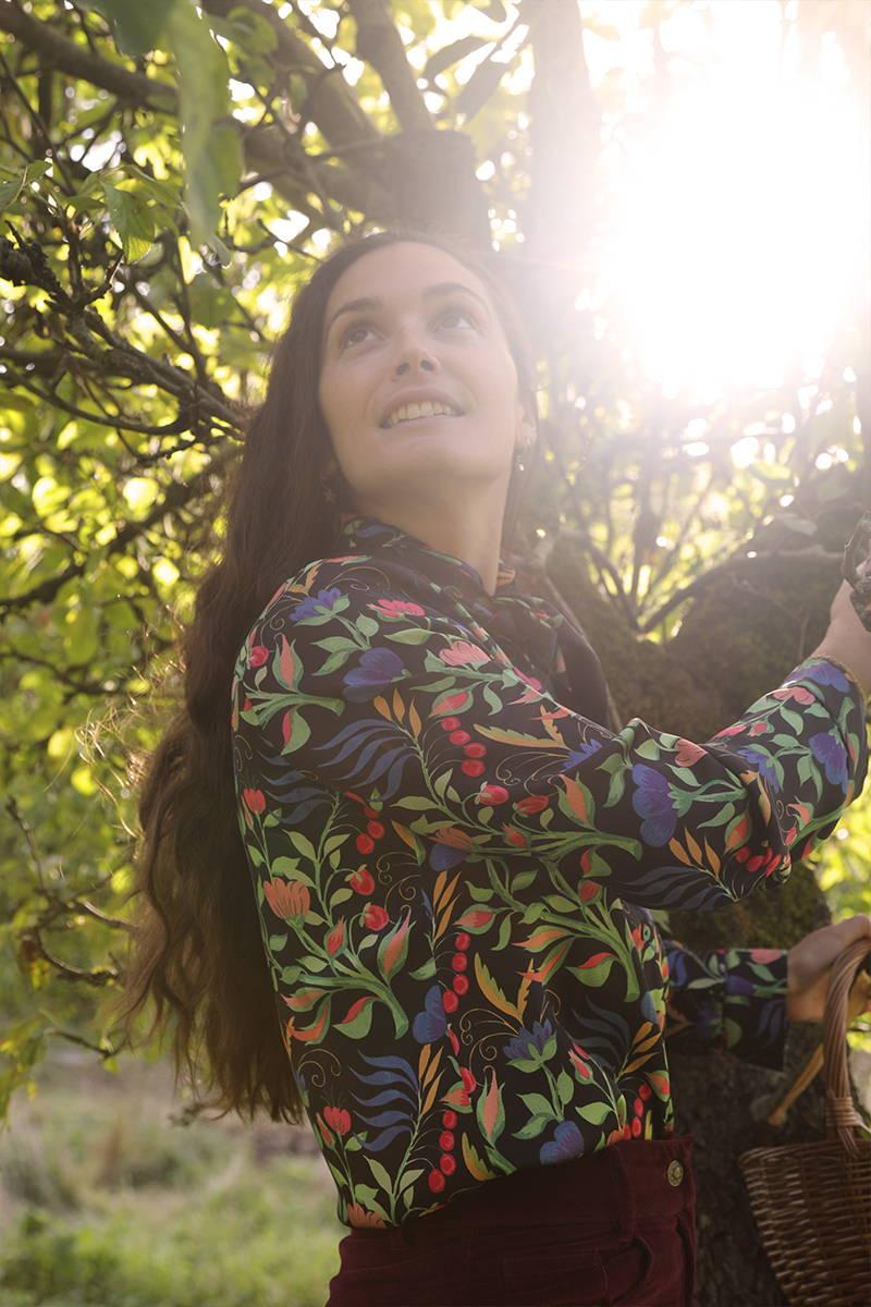 Harriette Tebbutt of Kitten Grayson Flowers picking apples in YOLKE Anais Silk Pyjamas