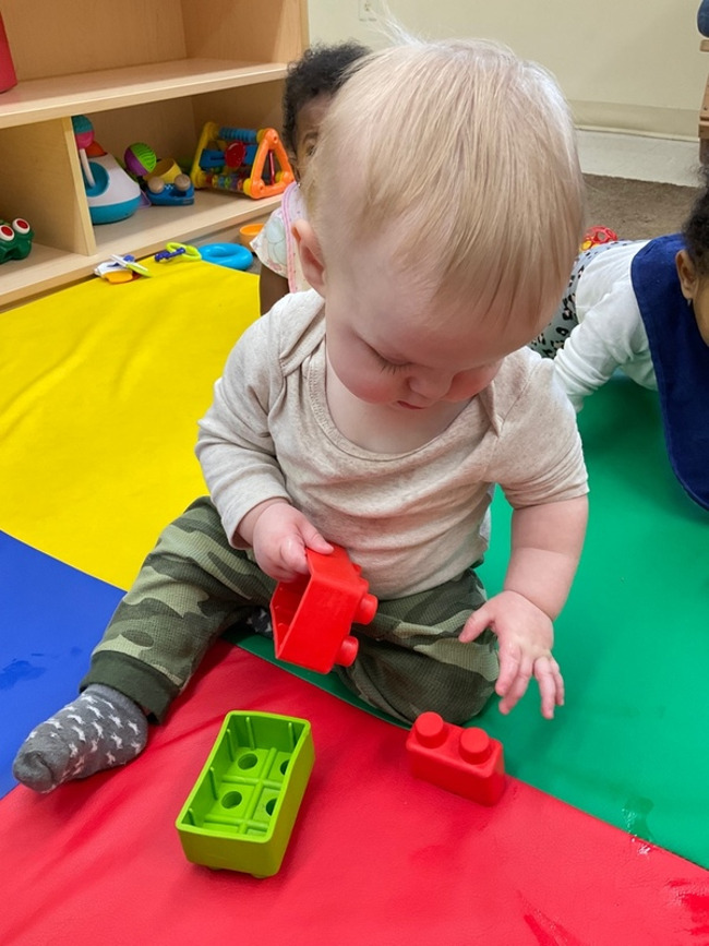 Young Infant 2 playing with blocks