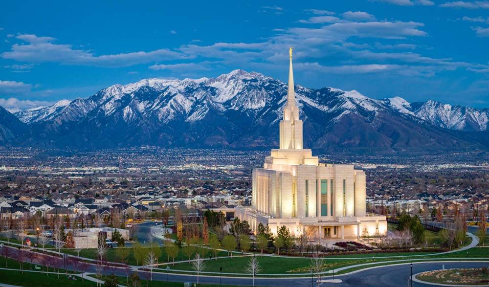 LDS art panoramic photo of the Oquirrh Mountain Temple and surrounding area against the mountains.