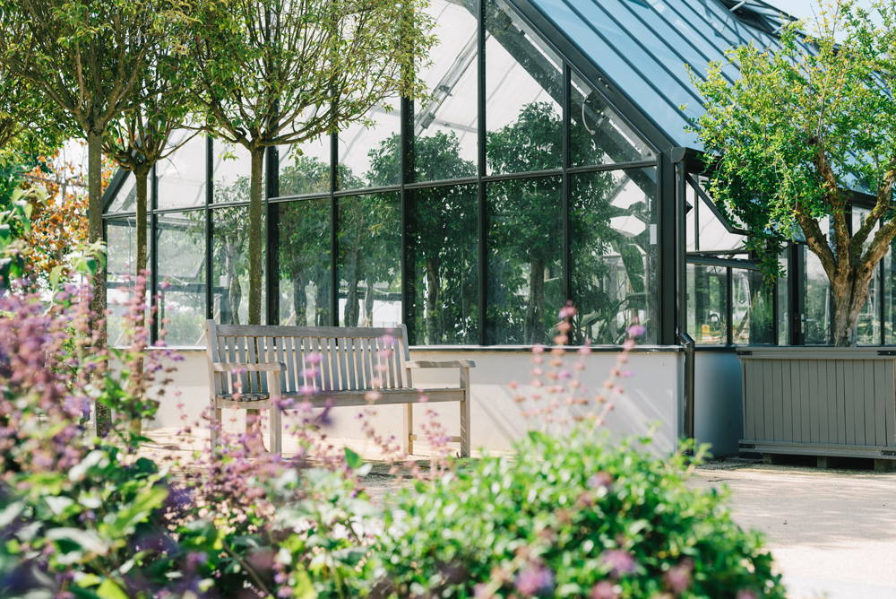 image of the greenhouse in the davines village garden