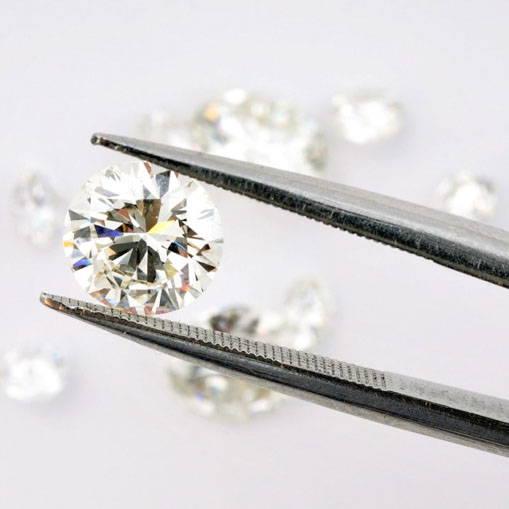 A lab-grown diamond on a grey background