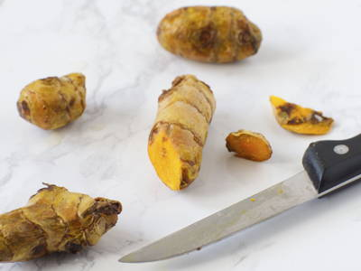 Cut off moldy parts of the skin, if any. Rinse turmeric roots and optionally, remove the skin of turmeric using a spoon or knife before using.