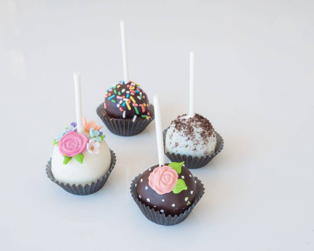 Sprinkle and flower topped cake pops
