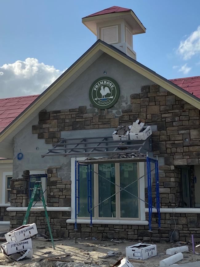Primrose logo on front of building under construction