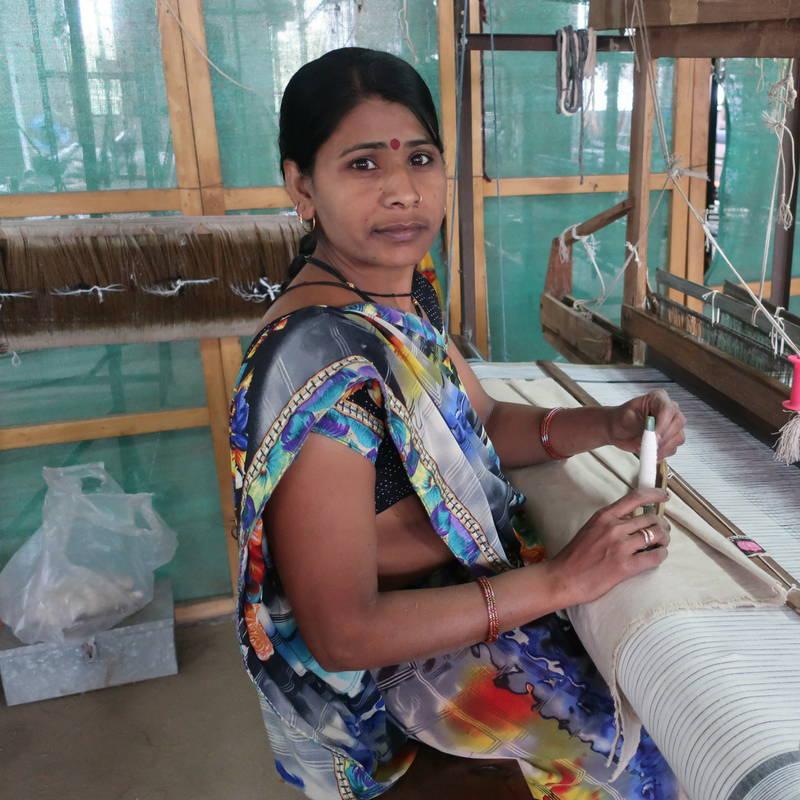 woman wearing a sari on handloom in india making khadi