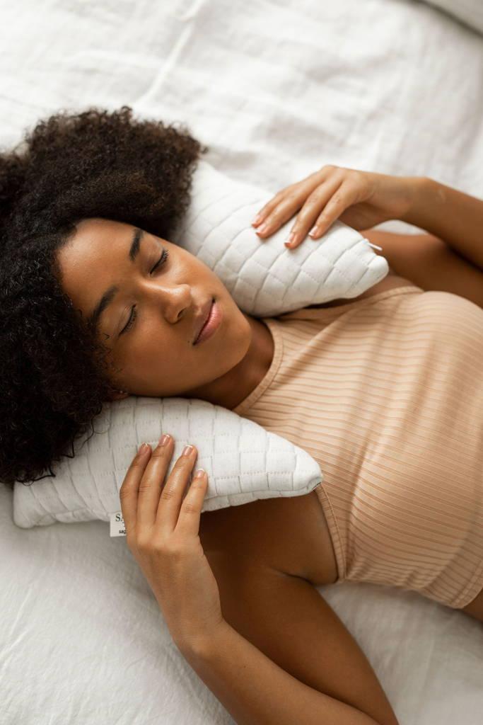 Woman Sleeping well  with sage sleep pillow