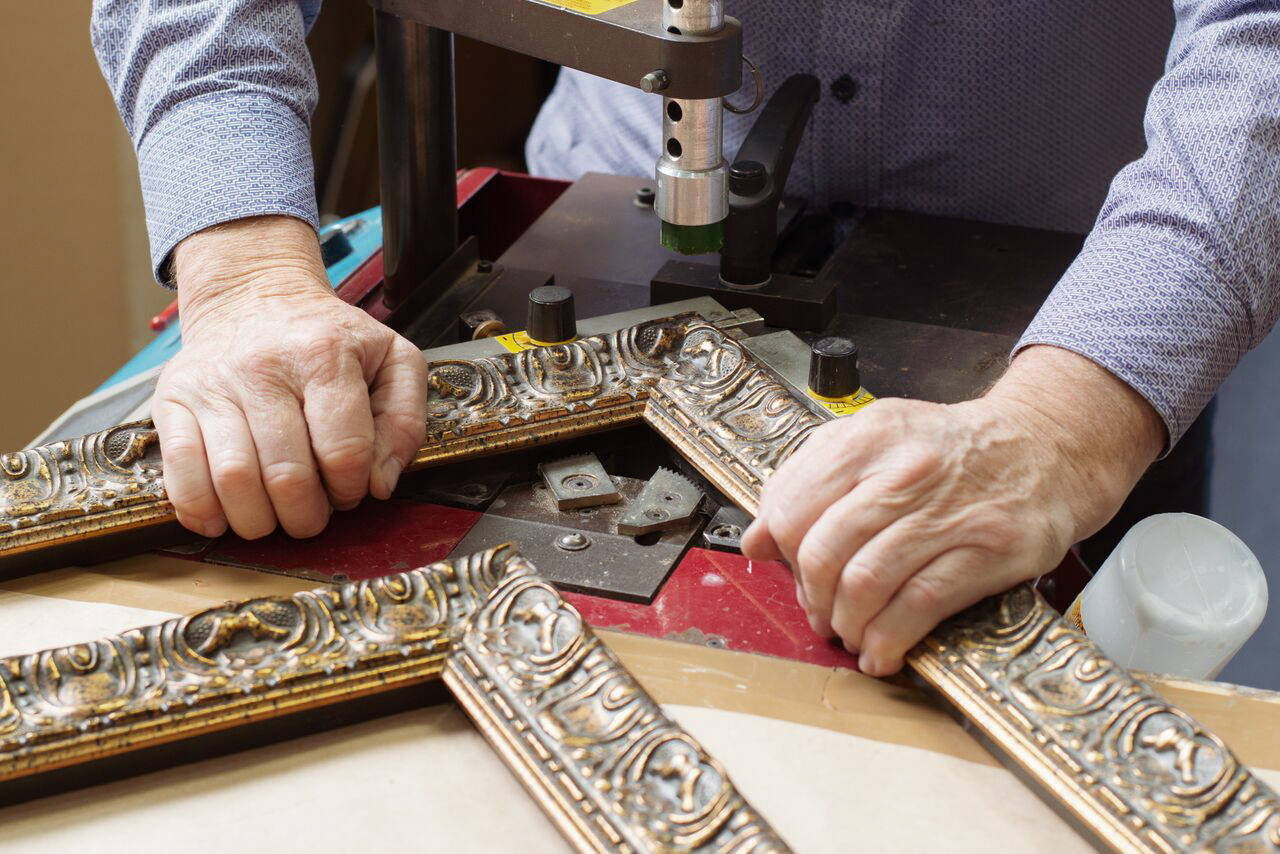 Joining an ornate frame in the workshop