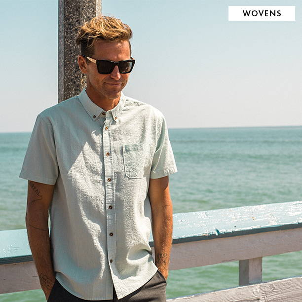 Shop Boardshorts. Man Surfing