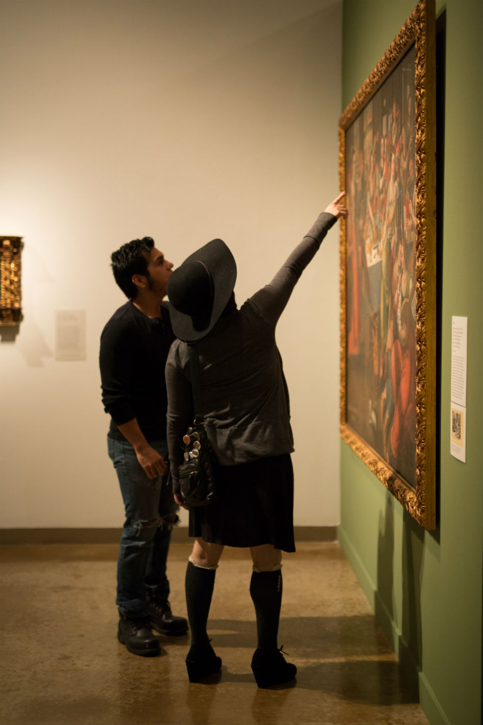 People looking at painting.