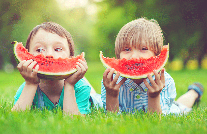 image of little boys eating watermelon