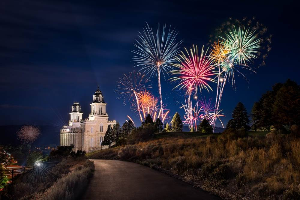 Photo of the Manti Temple with a sky full of 4th of July fireworks.