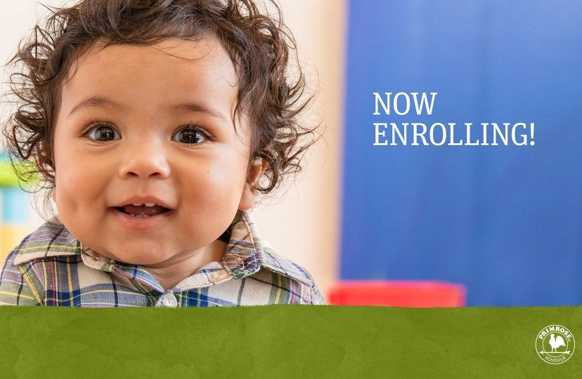 toddler with brown hair smiling with words Now Enrolling