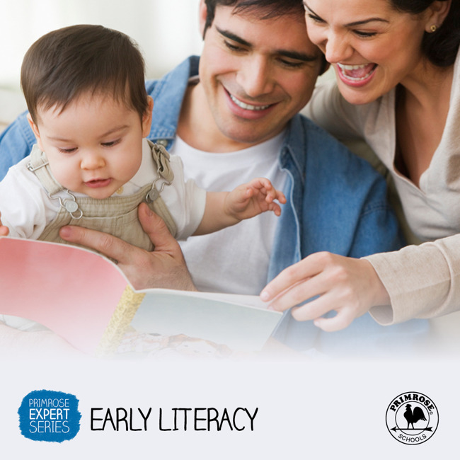 Mother and father read to their baby boy who excitedly pints to the story book