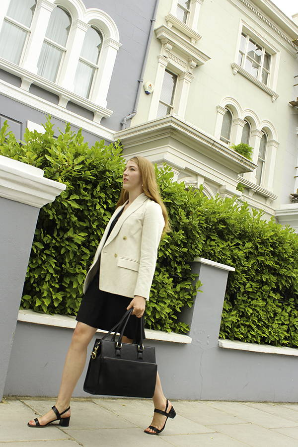business woman in her way to the office carrying her evora bag