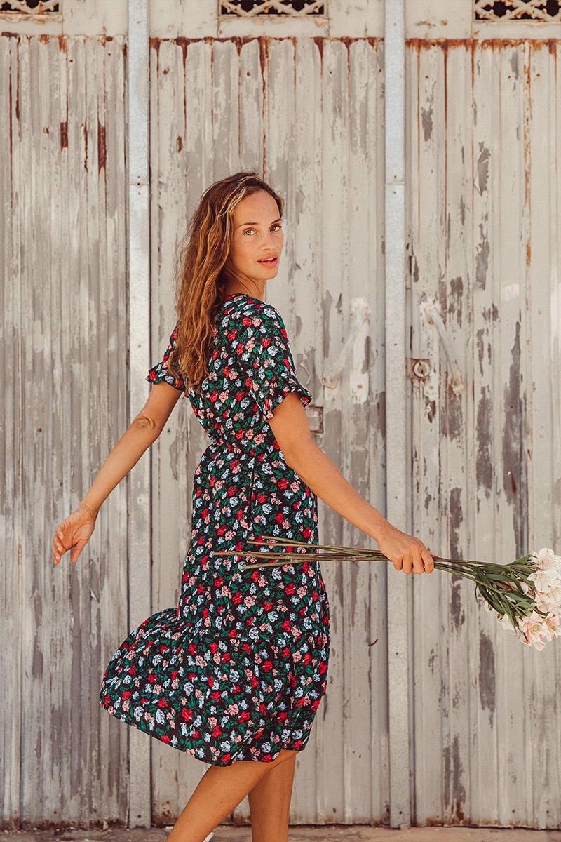 Anastasia Yakhnina Twirls in YOLKE's Colette Folktails Dress whilst holding flowers