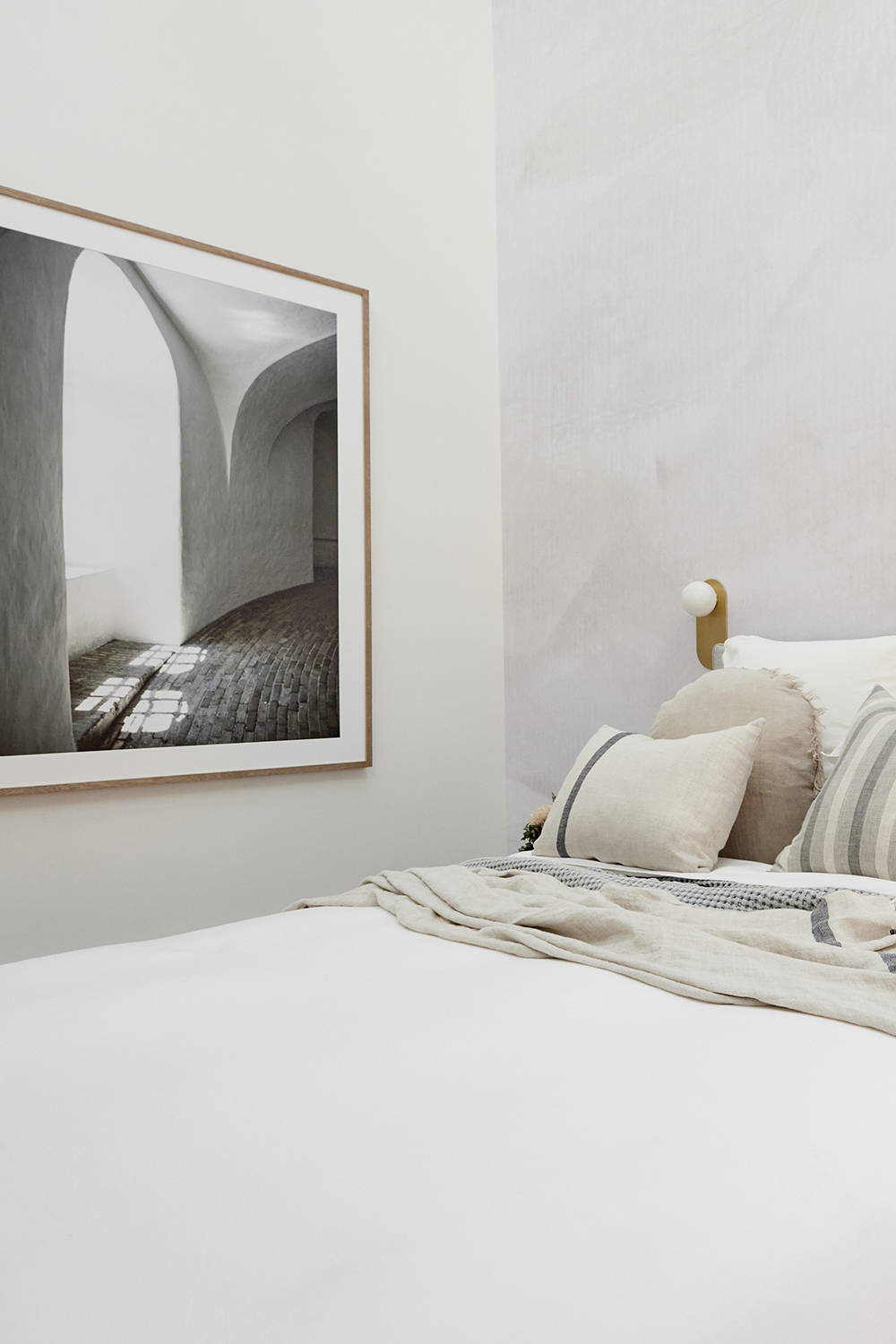 Framed Print in Ronnie and Georgia's The Block Guest Bedroom - A neutral bedroom interior with a moody framed artwork framed in oak