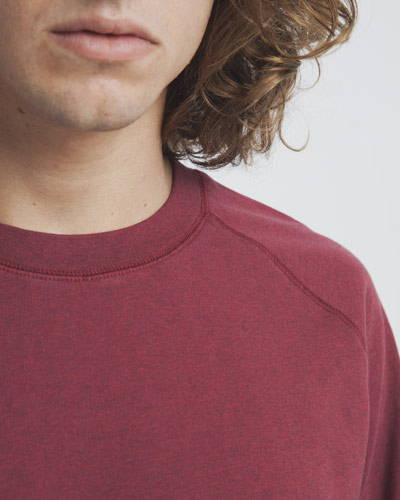 Crew neck close up of burgundy red mens organic cotton sweatshirt
