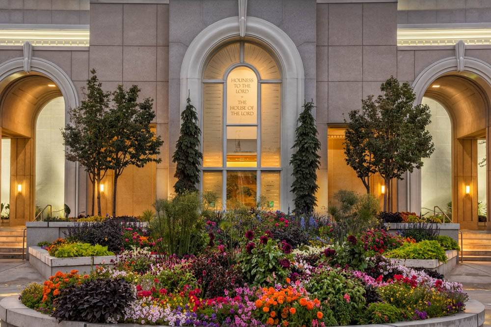 LDS art close-up photo of the Mt Timpanogos Temple entrance and flower beds.