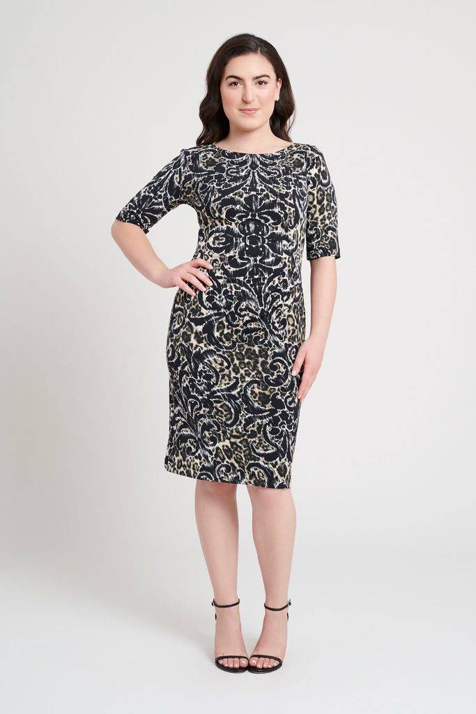 young dark haired woman in grey fleur-de-lis and cheetah print half sleeve connected apparel work dress