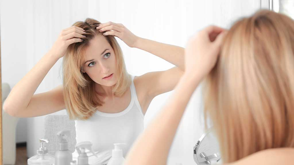woman checking her hair part