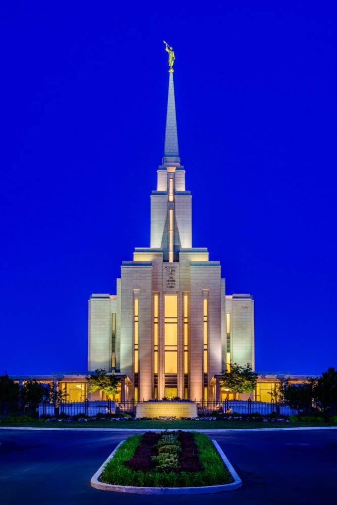 LDS art vertical photo of the Oquirrh Mountain Temple against a bold-blue, evening sky.