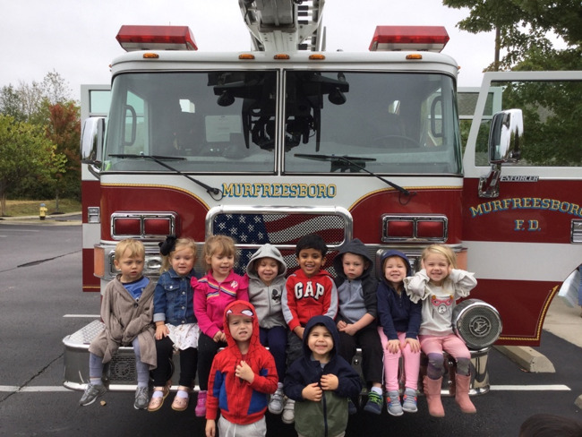 Children in front of a firetruck