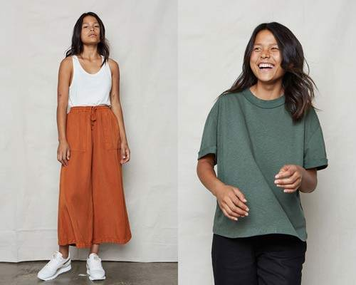 Woman wearing ochre orange Tencel wide leg trousers with white sports trainers and white vest top and woman wearing army green boyfriend fit organic cotton and hemp t-shirt from sustainable womenswear brand Back Beat Rags
