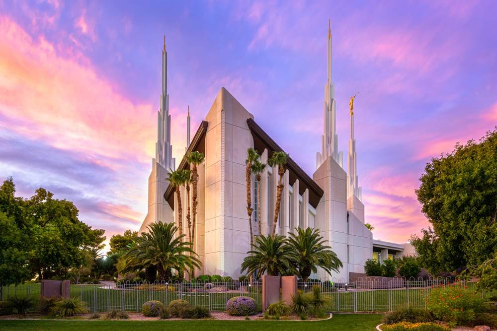 Photo of Las Vegas Nevada LDS Temple surrounded by green plants and pink clouds.