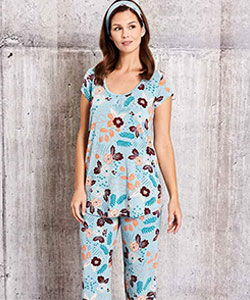 Model wearing ThisisJ Tessa Flower one-piece bamboo pajamas