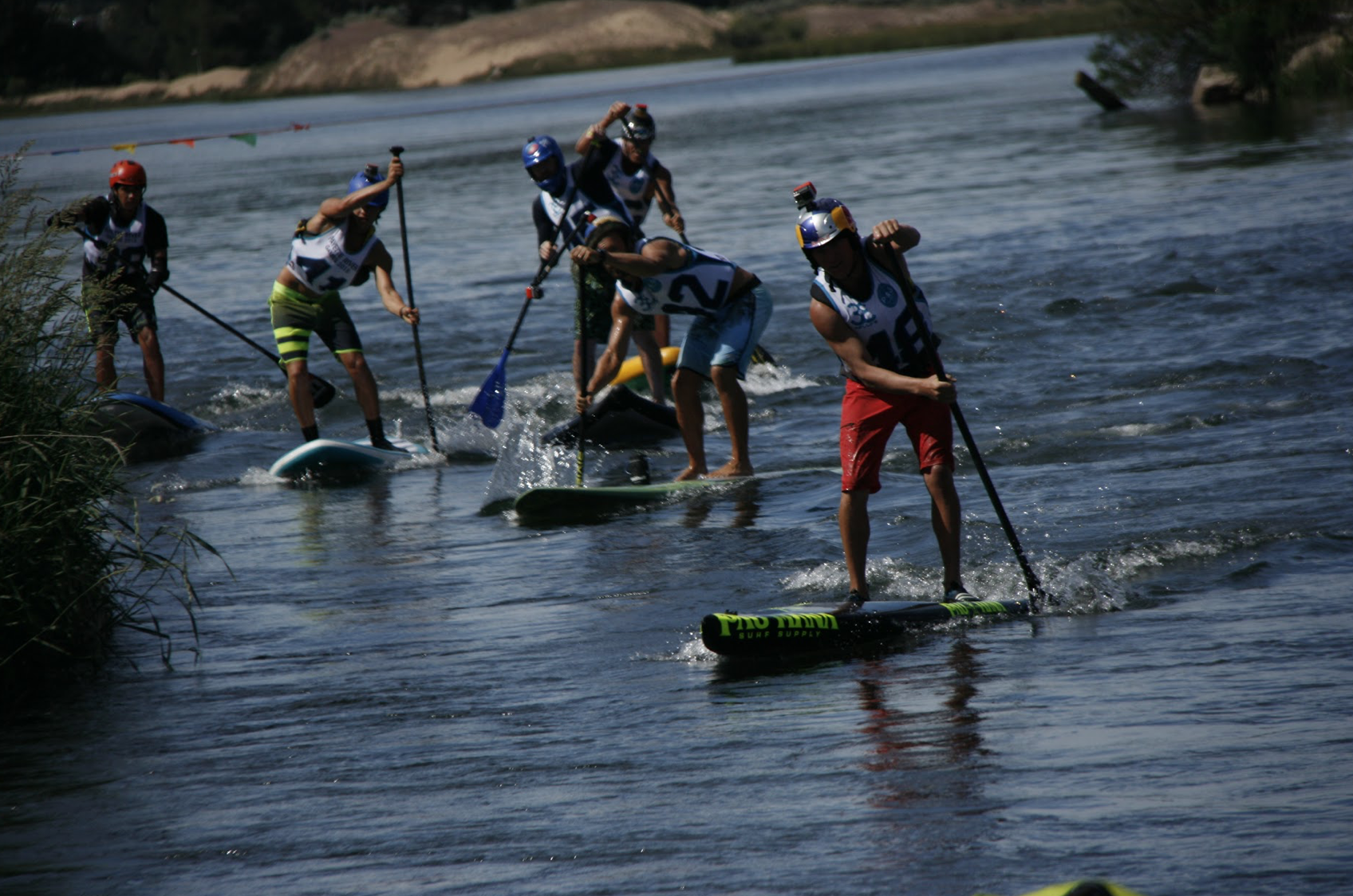 Paddling on the Pau Hana Surf Supply racing board in Idaho