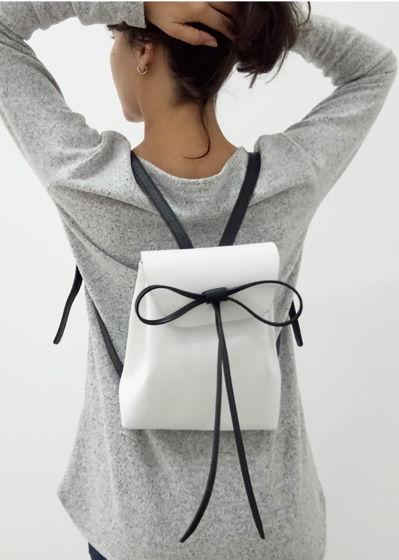 Кожаный женский рюкзак ручной работы с бантом