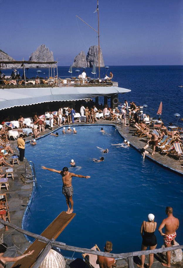 A bright blue ocean and pool scene captured by vintage photographer Slim Aarons
