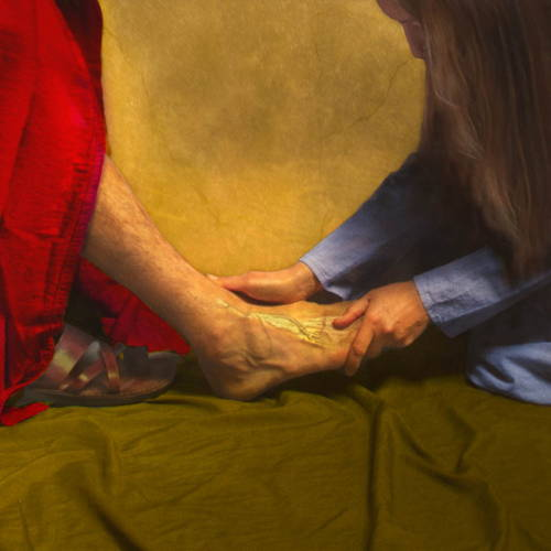 Up-close image of Mary's hand's anointing Jesus' feet
