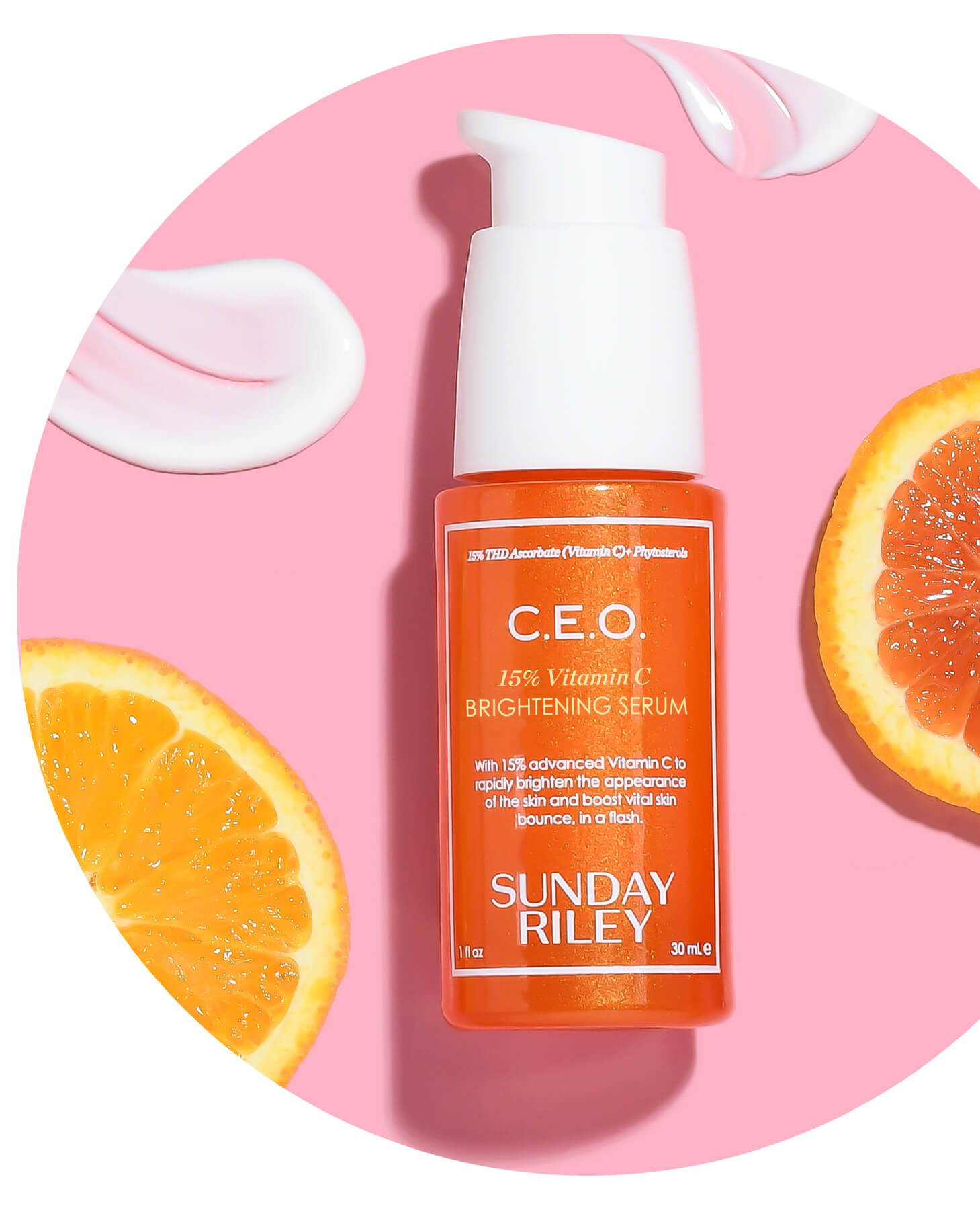 c.e.o. 15% vitamin c brightening serum bottle with orange slices and goops on pink background
