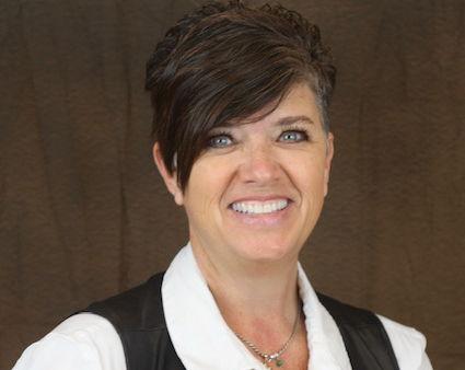 Mrs. Solis , Executive Director