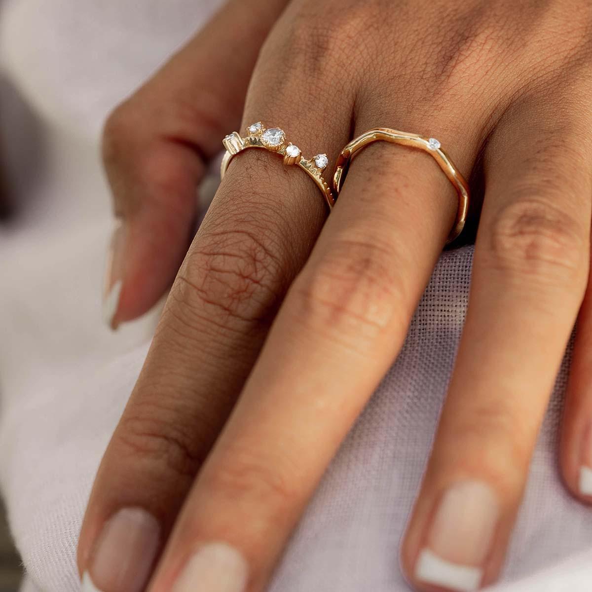 Hands wearing Scéona rings
