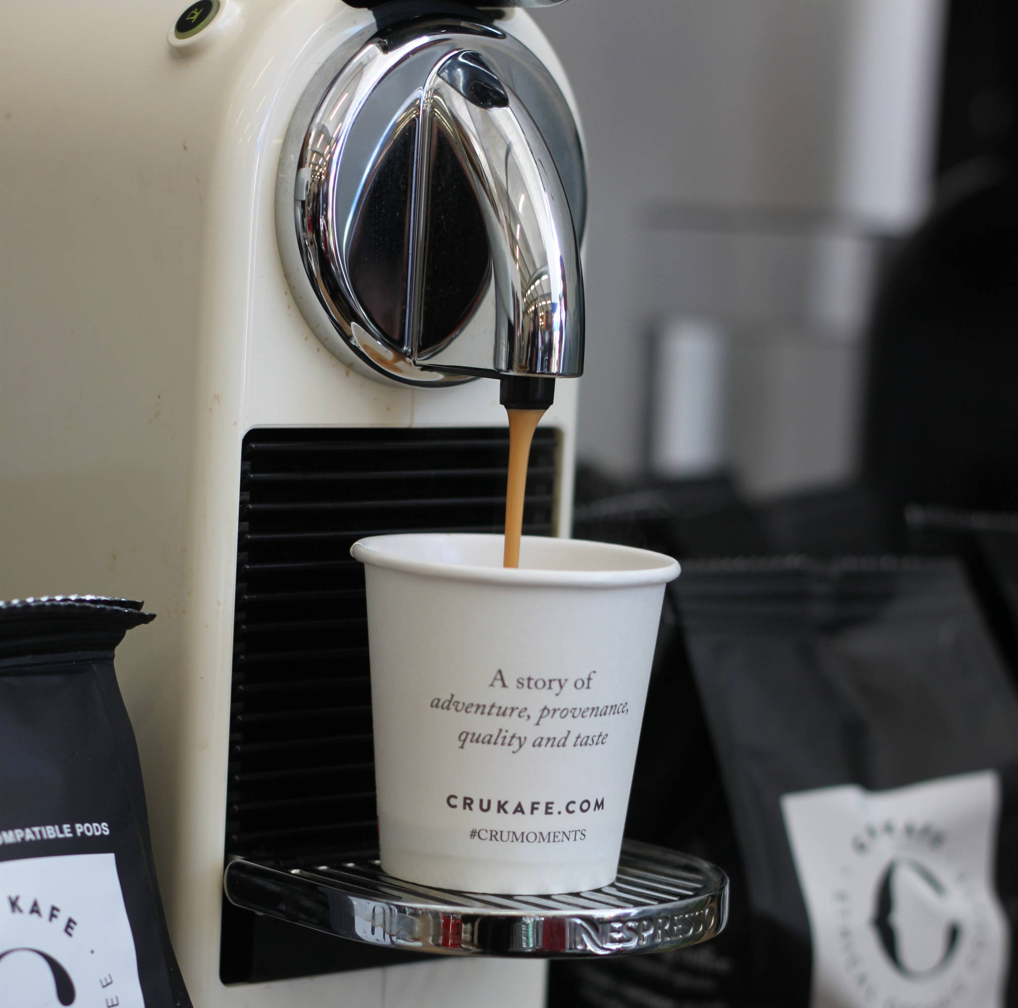 CitiZ Nespresso® Machine pouring CRU Kafe coffee pod