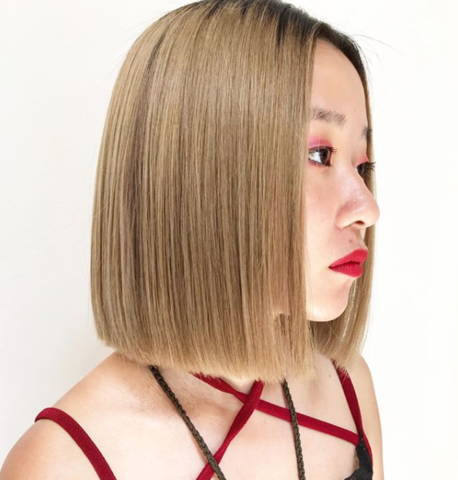 side view of woman with light brown blunt bob hair cut