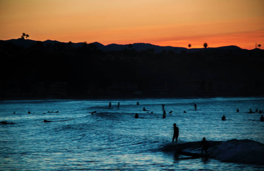 Doheney State Beach Park in Dana Point California at sunset with surfers
