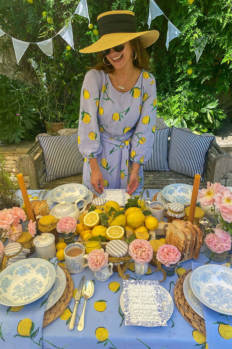 Rowan Blossom stands in front of her lemon tablescape
