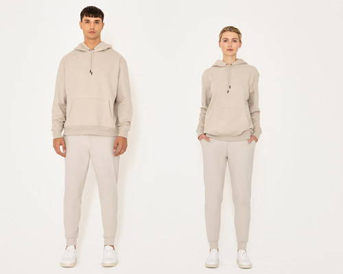 Man and woman wearing matching beige oversized hoodie and sweatpants made by sustainable streetwear brand Riley Studio