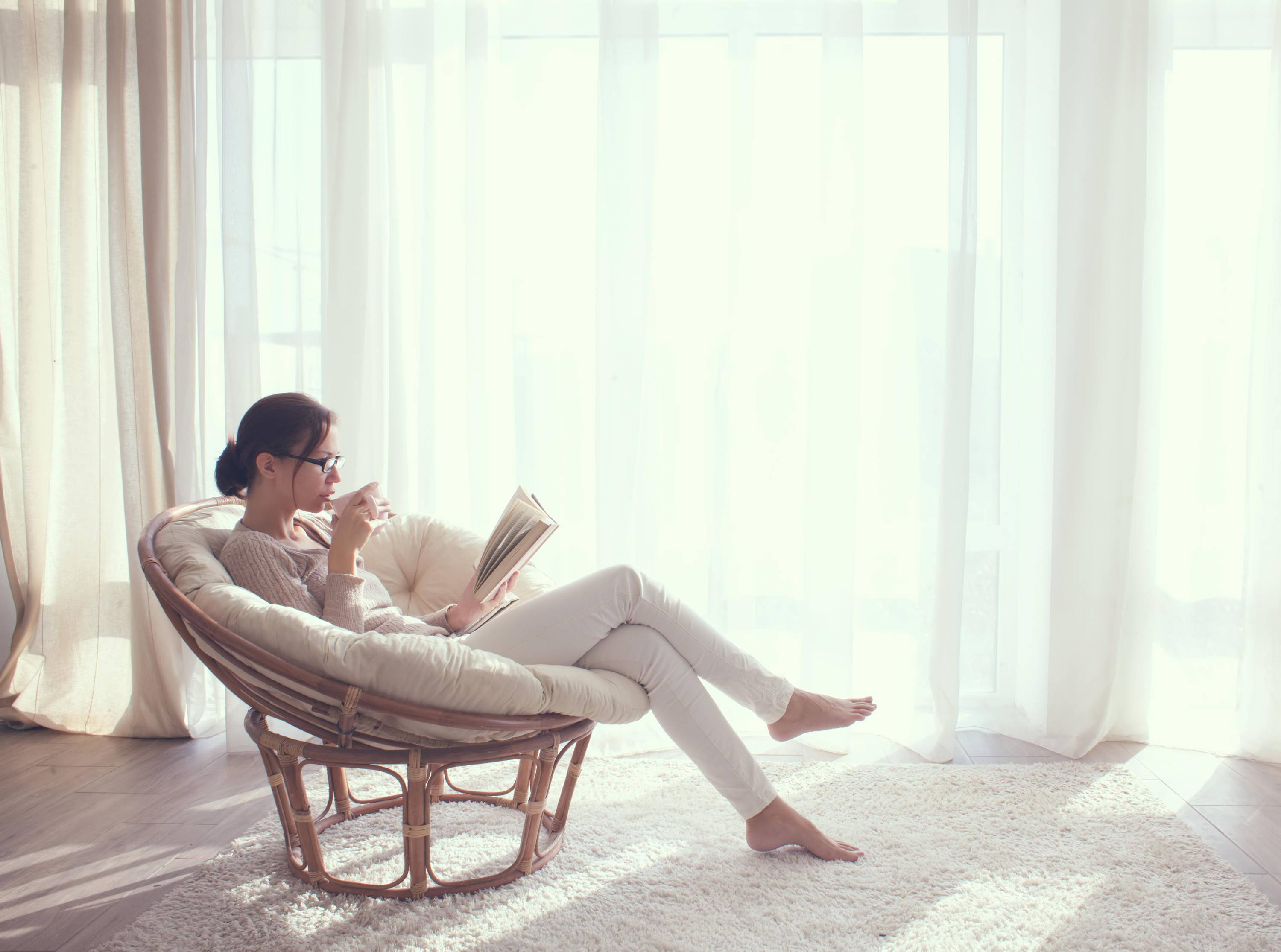 woman reading book cup of tea take a break me time time out happiness self-care well-being