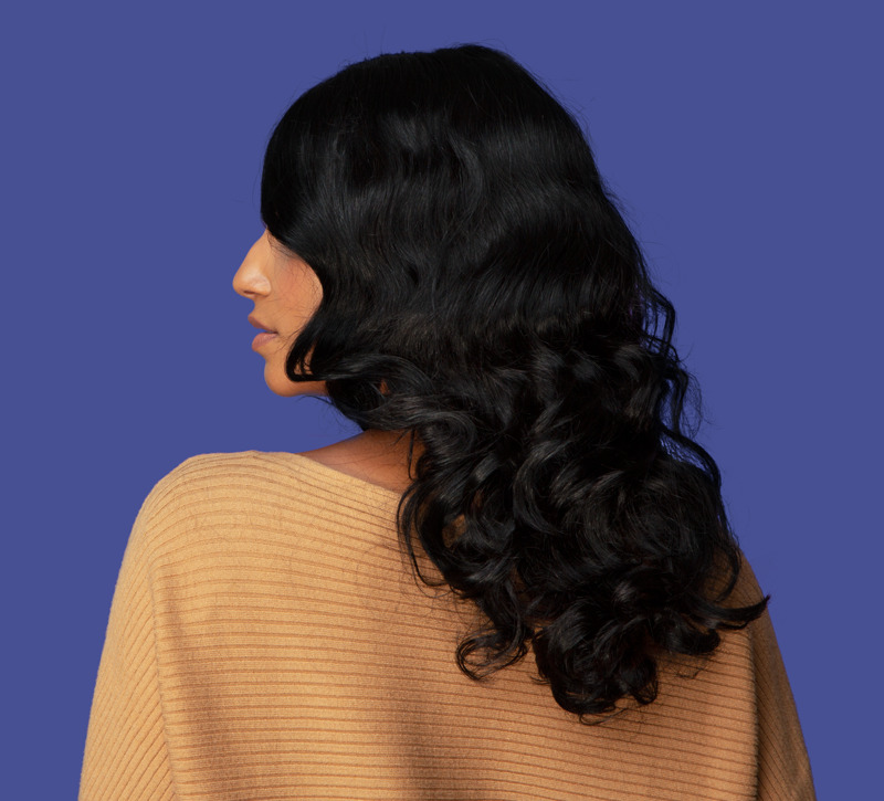 woman with a 15 inch straight wavy hair wig