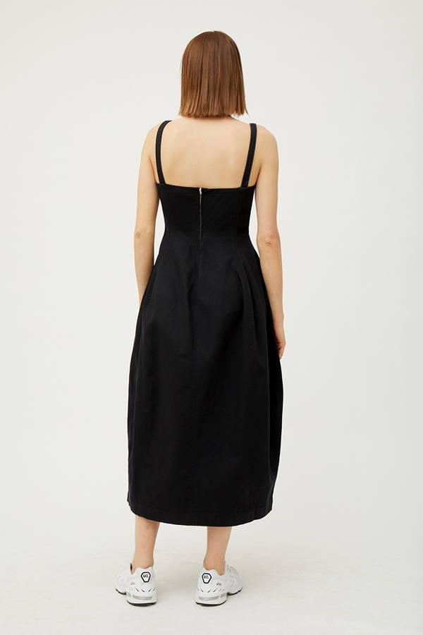 Back of woman wearing black organic cotton dress
