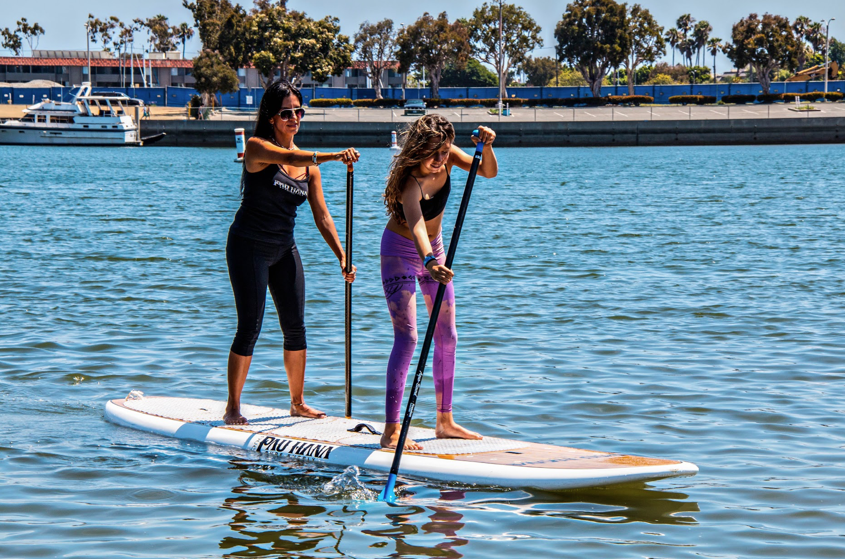 paddling the Duo tandem pau hana stand up paddle board in Venice